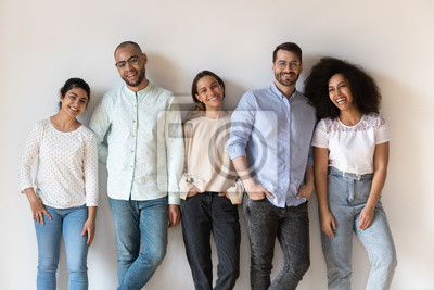Naklejka Portrait of smiling young diverse people standing in row