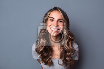 Naklejka Portrait of young beautiful cute cheerful girl smiling looking at camera.