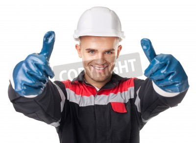 Naklejka Portrait of young smiling worker in protective gloves giving thumb up isolated on white background
