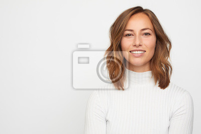 Naklejka portrait of young woman isolated on white