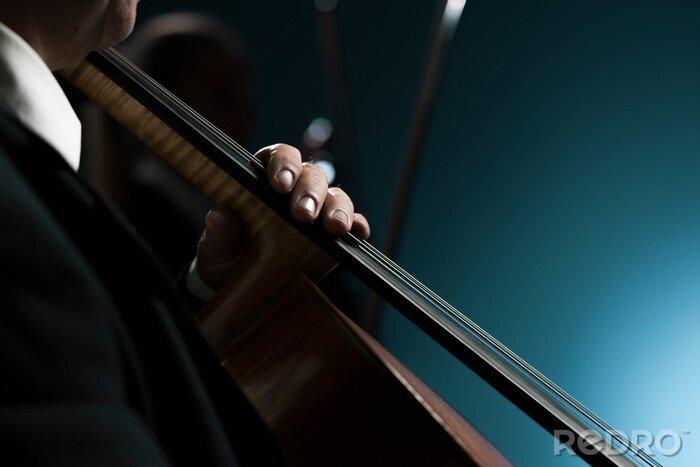 Naklejka Professional cellist performing hands close up