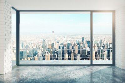 Naklejka Pusty pokój na poddaszu z dużym oknem na piętrze i widok na miasto