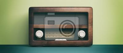 Naklejka Radio old fashioned Radio old fashioned on green pastel wall background. 3d illustration