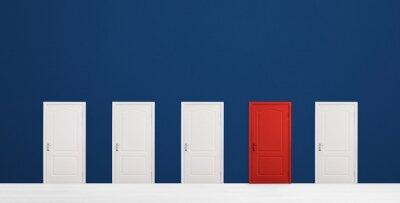 Naklejka Red door among white ones in room. Concept of choice