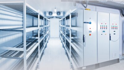 Naklejka Refrigeration chamber for food storage. Control panels of the refrigerator. Concept - sale of freezing equipment. Equipment for food storage. Cooling. Industrial cold store with empty counters