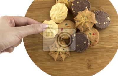 Naklejka Ręka trzyma biały ciasteczko