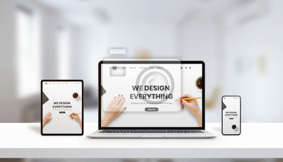 Naklejka Responsive agency web page on laptop, tablet and phone display concept. Modern, flat web page design. Modern devices with thin edges. Office, studio desk