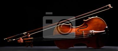 Naklejka retro violin on a black background
