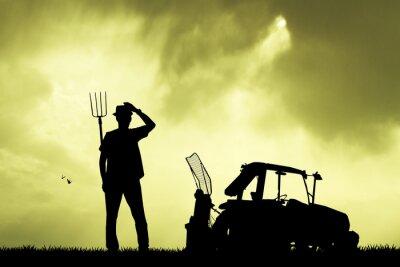 Naklejka Rolnik i traktor w polu