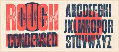 Naklejka Rough Condensed Font. Works well at small sizes. Individually textured characters with an eroded rough letterpress print texture. Unique design font