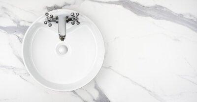 Naklejka Round bathroom washing sink on marble stone surface, top view