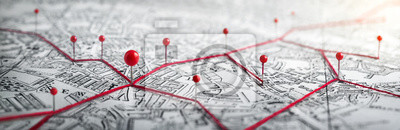 Naklejka Routes with red pins on a city map. Concept on the  adventure, discovery, navigation, communication, logistics, geography, transport and travel topics.