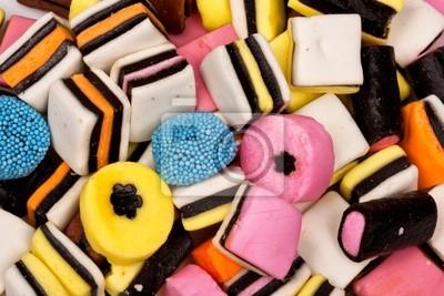 Naklejka Różne wszelkiego rodzaju słodycze w stos