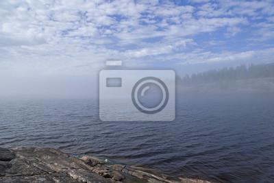 Naklejka Rzadkie zjawisko pogodowe - chmura na powierzchni jeziora w słoneczny dzień. Karelia, Rosja.