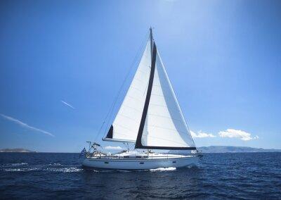 Naklejka Sailing Yacht from sail regatta race on blue water Sea.