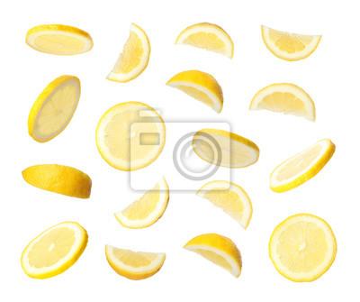 Naklejka Set of flying cut fresh juicy lemon on white background