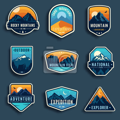 Naklejka Set of nine mountain travel emblems. Camping outdoor adventure emblems, badges and logo patches. Mountain tourism, hiking. Forest camp labels in vintage style