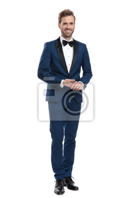 Naklejka sexy smiling man in blue suit holding his hands together