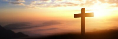 Naklejka Silhouette of catholic cross at sunset background. panorama picture