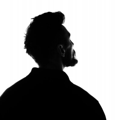 Naklejka Silhouette of male person , back view back lit over white