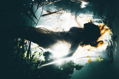 Naklejka Silhouette underwater girl with long hair. Swimming Mermaid.