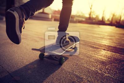 Naklejka Skateboarder skateboarding at sunrise city