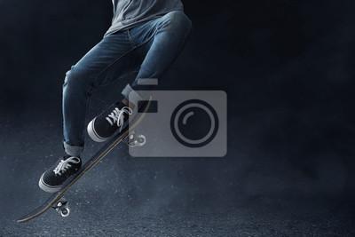 Naklejka Skateboarder skateboarding on the street