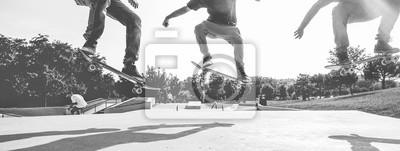 Naklejka Skaters jumping with skateboard in city park