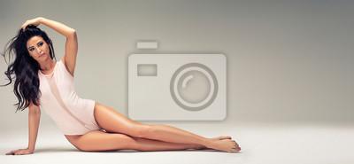 Naklejka Slim beautiful girl posing in studio.