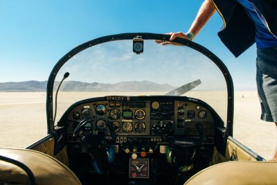 Naklejka small aircraft dashboard interior view in the desert