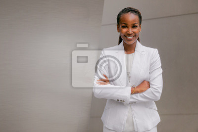 Naklejka Smiling cheerful headshot portrait of an african businesswoman, corporate executive, business career professional in swanky stylish suit