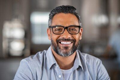 Naklejka Smiling indian man looking at camera