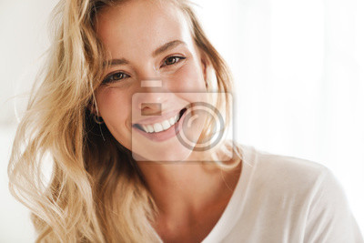 Naklejka Smiling young beautiful blonde woman wearing t-shirt