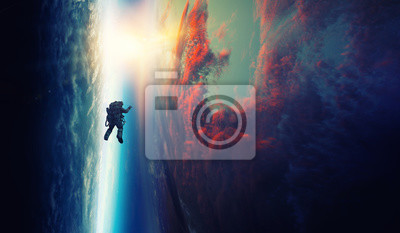 Naklejka Spaceman and planet, human in space concept