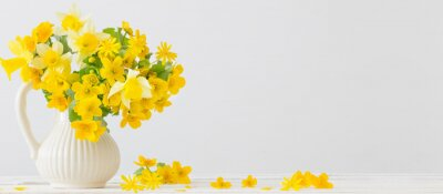 Naklejka Still life with yellow spring flowers in jug