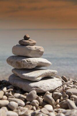 Naklejka Stos kamieni, zen koncepcji, na piaszczystej plaży