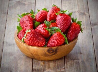 Naklejka strawberries in a wooden bowl