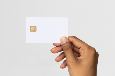 Naklejka Studio shot of ethnic hand holding a credit card