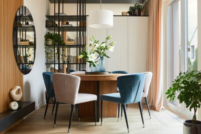 Naklejka Stylish composition of elegant dining room interior design with velvet armchairs, design rouded wooden table and beautiful personal accessories. Glamour interior design inspiration. Template.