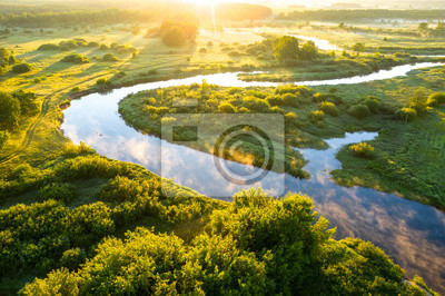 Naklejka Summer morning on the river with fog, aerial view. River located between forest and green fields