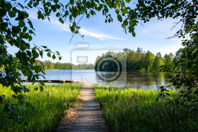 Naklejka Summer view to the river Mustio and wooden walkway from the Mustion Linna park, Finland