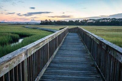 Naklejka Sunrise over the marsh along the Tolomato River in St. Augustine, Florida.