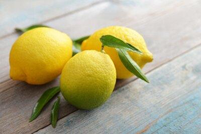 Naklejka Świeże cytryny z liśćmi