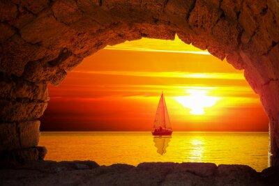 Naklejka Sylwetka łodzi o zachodzie słońca