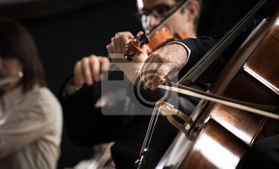 Naklejka Symphony orchestra: cello player close-up