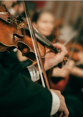 Naklejka Symphony orchestra on stage, hands playing violin