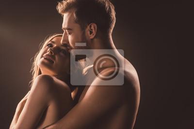 Naklejka szczęśliwi kochankowie naga przytulanie i patrząc na siebie, na brązowo