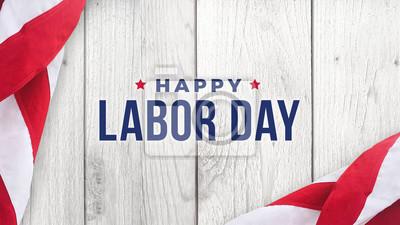 Naklejka Szczęśliwy dzień pracy tekst nad białym tle ściany z drewna tekstury i flagi amerykańskie