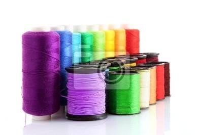 Naklejka Szpulki Kolorowe nici na białym tle