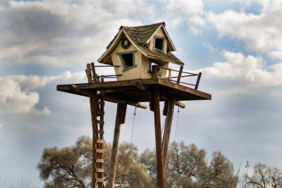 Naklejka Tall tree house on a farm